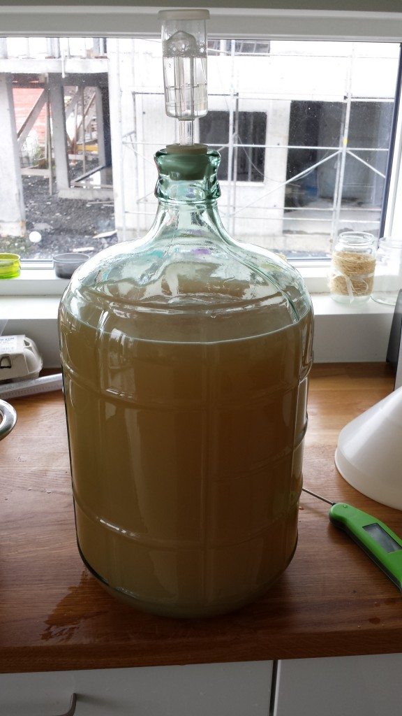 After adding cold water to the pot it's safe to transfer the now cold pee from pot into carboy